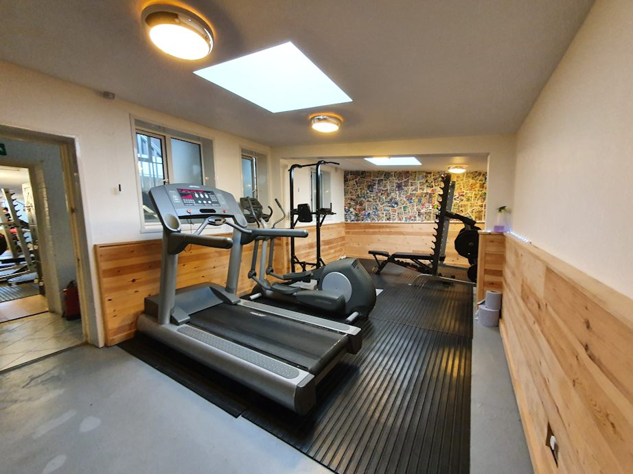 JG Fitness Centre rear gym showing runner, cross-trainer and squat rack