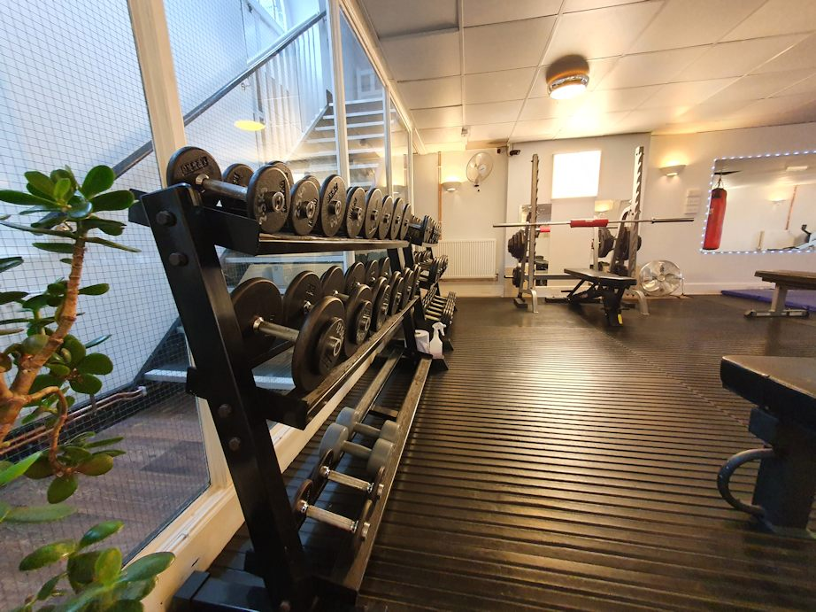 JG Fitness Centre showing dumbbells and squat rack